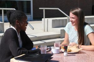 Not able to utilize senior privileges yet, underclassmen like Nyla Robinson '17 (Left) and Rebecca Rowlands '17 (Right) spend lunch time on campus.
